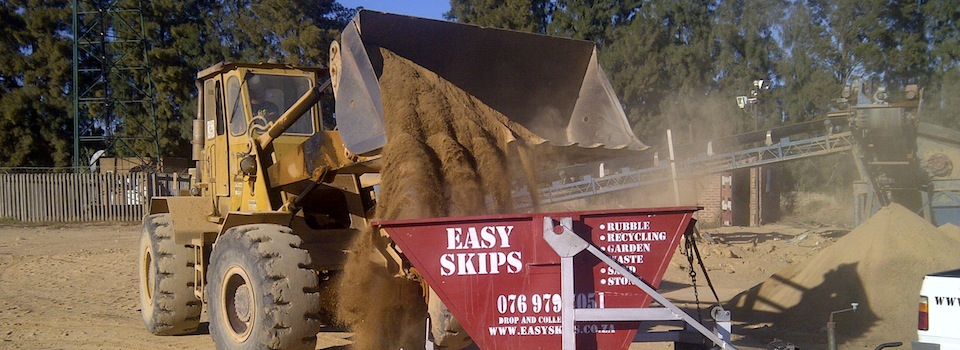 Tipping stones in a EasySkips bin with trailer