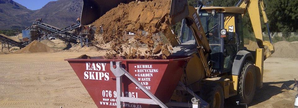 Loading an EasySkips bin with sand